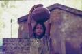 1.25-1984-katjuraho-19-girl-with-water0001